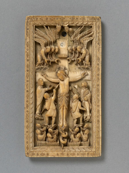 Crucifixion from the V&A Museum.  The serpent is among the resurrecting dead on the axis of the cross.  Rheims, France (probably, made) Date:ca. 860-870