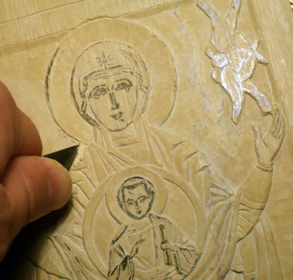 Carving a steatite icon.