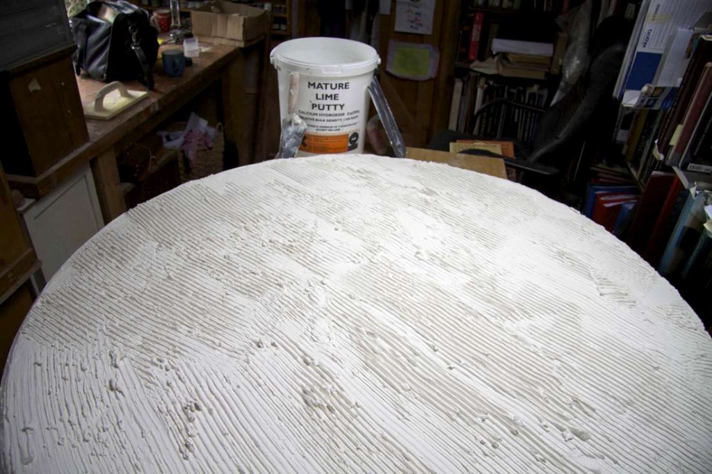 Lime putty spread to dry before setting mosaic tesserae