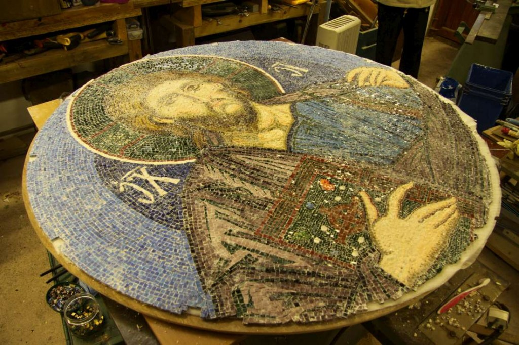 The back of the mosaic with lime putty removed, with the front side still stuck to the cloth