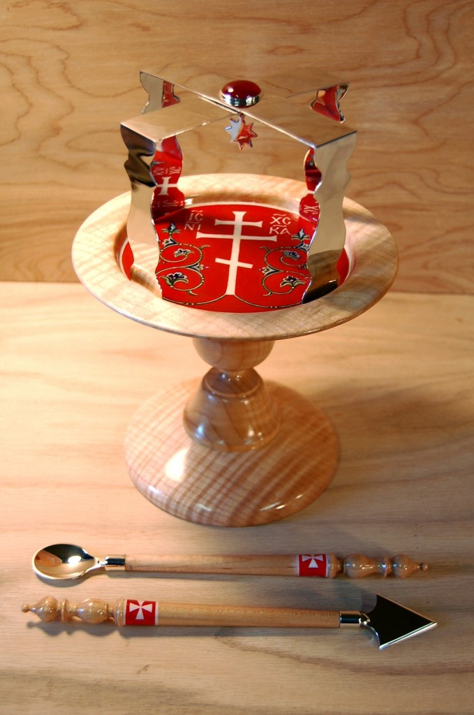 Painted wooden diskos, spear, and spoon, with sterling silver asterisk and other mounts, designed by the author.