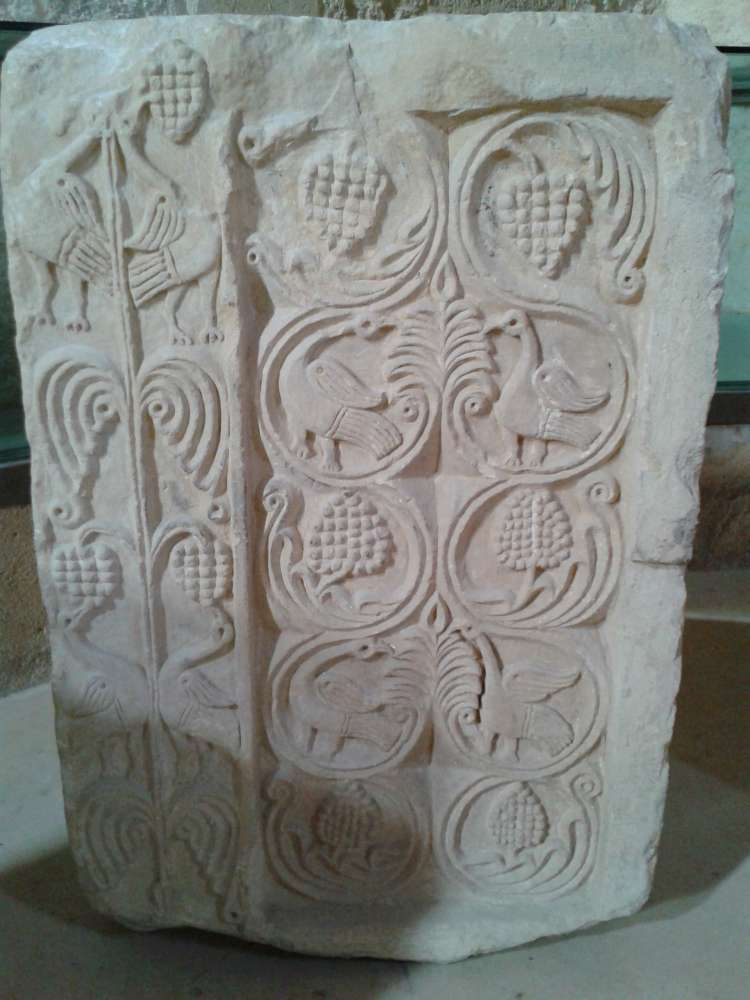 An early Spanish carved stone, typical of the Byzantine-influenced architecture of the Visigothic period.