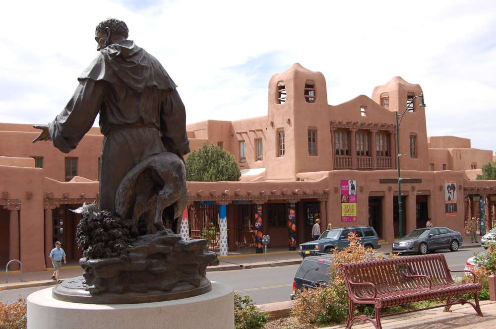 The architecture of downtown Santa Fe. In 1912 the city passed a law requiring all construction to be in the historic Pueblo/Mission style. This resulted in grand Pueblo-Revival buildings of the 1920s, such as this one, and has helped preserve the local building tradition to this day.