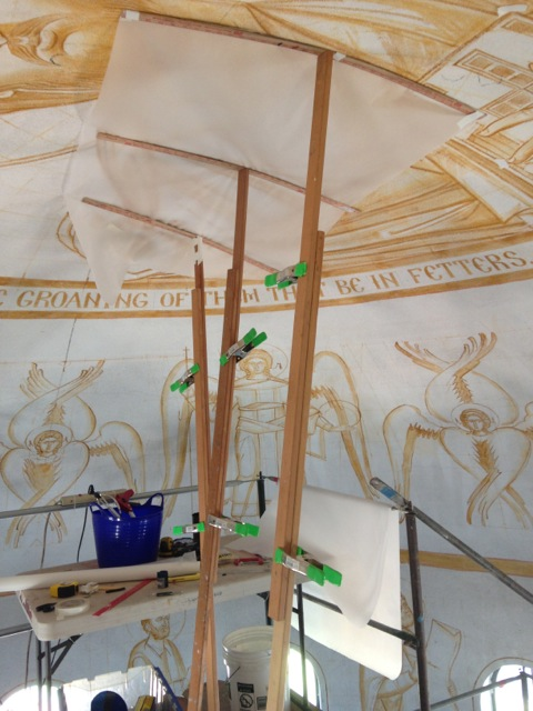 Elements of the original sepia drawing that need to be saved are traced onto paper prior to application of plaster.