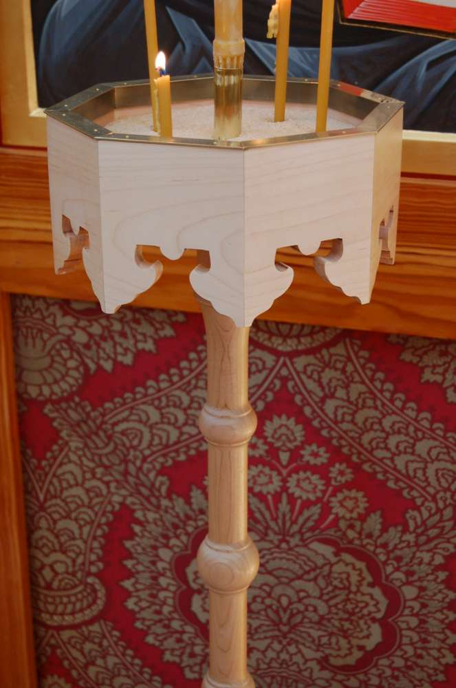 A candelabrum in the style of 17th-century Russian woodwork, with hand-cut fretwork. Made by the author.