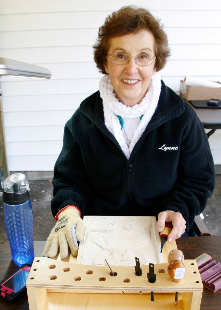 Lynne Attaway enjoying the hard work of carving full time for six days.