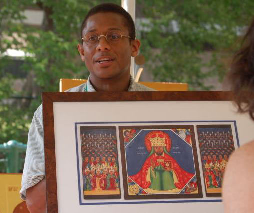 "Christopher Gosey with his icon of the ""Conquering Lion of Judah"""