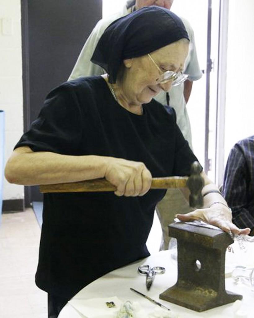 Ksenia crushing stones to make pigment