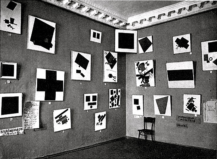 "Kasimir Malevich, Gallery Instillation of The Last Futurist Exhibition, 0.10. The ""red"" corner of Suprematism.  Notice the  non-objective ""icon"", the Black Square, hung up high in the corner."