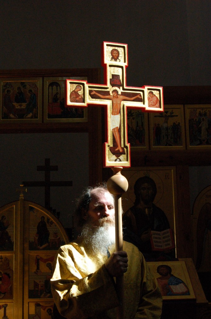 A painted wooden processional cross made by the author.