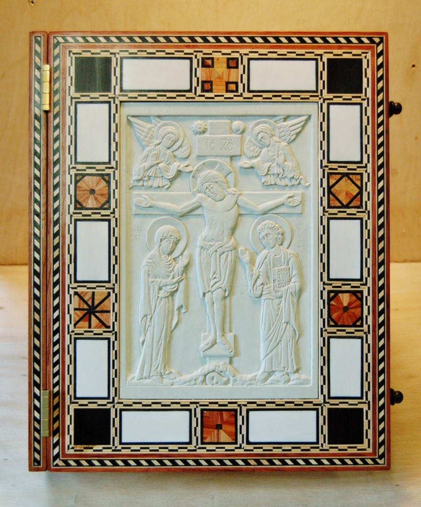 The front cover - inlaid woods and ivory with carved steatite icon