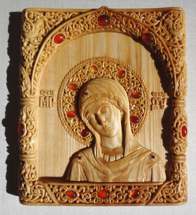 Theotokos. 15.7x17.6x1.9 cm. linden wood, inlaying with cornelians and garnets, natural linen oil varnish, 2012