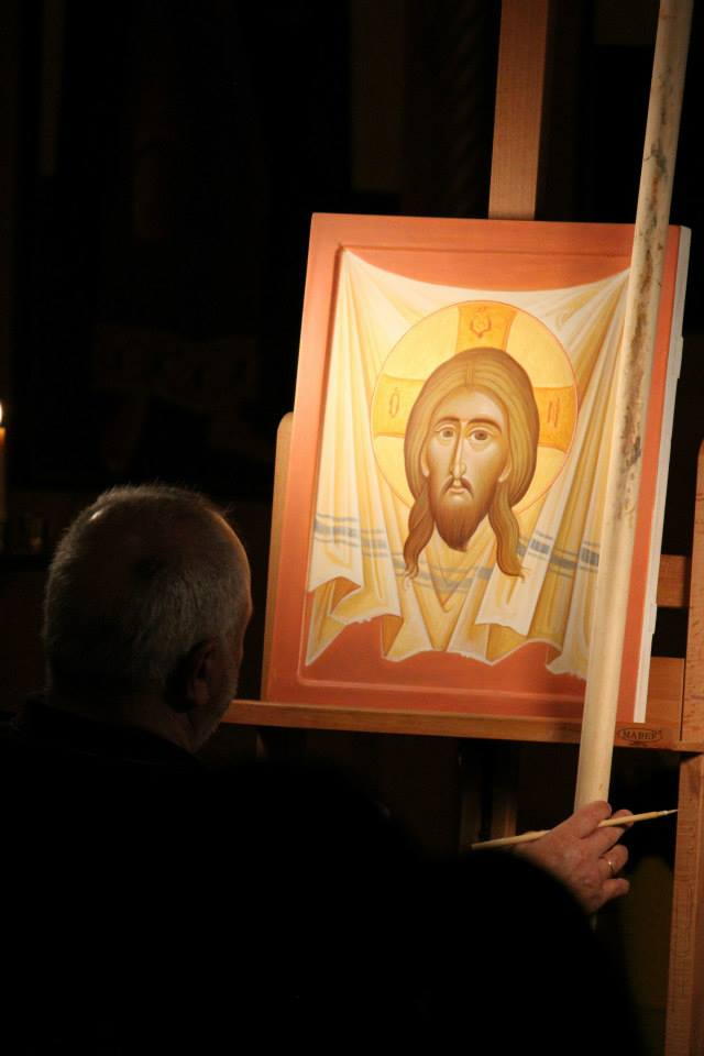 Kordis finishing up his icon painted during the two concert events.  Credit: Odarka Kish