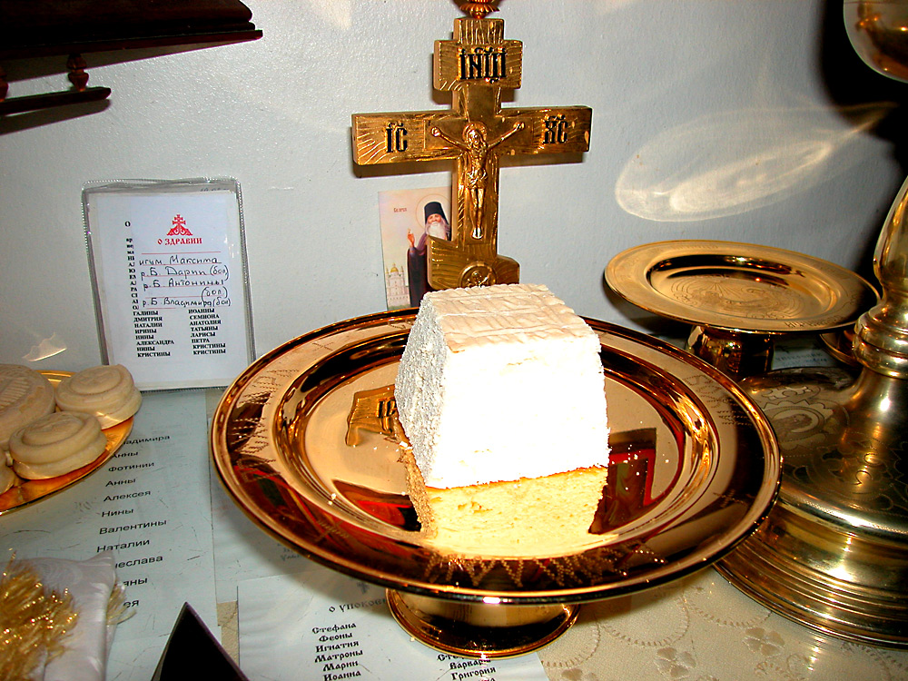 The lamb cut out from the round proshpora. Other pieces from the prosphora will be added to represent participation of saints and the rest of the church.