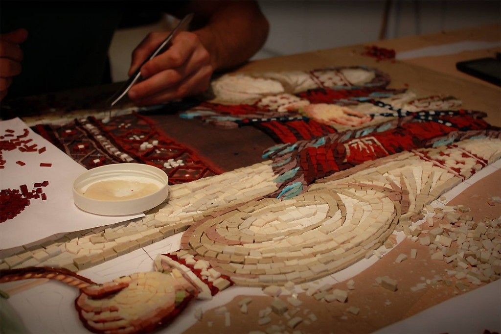 Artist working on a mosaic