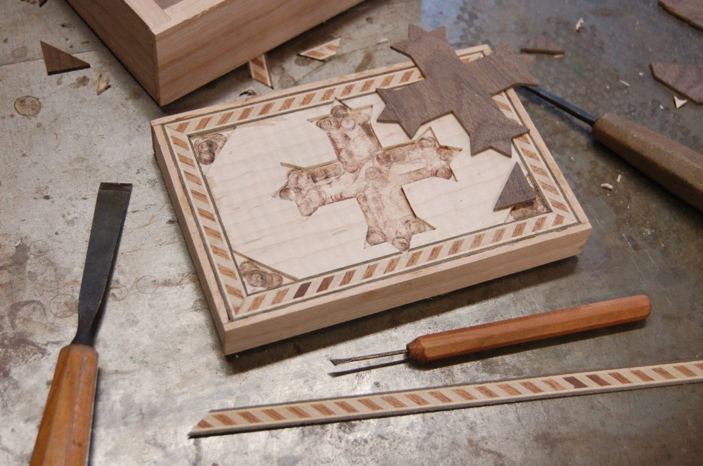 Inlaying the walnut cross into the incense box