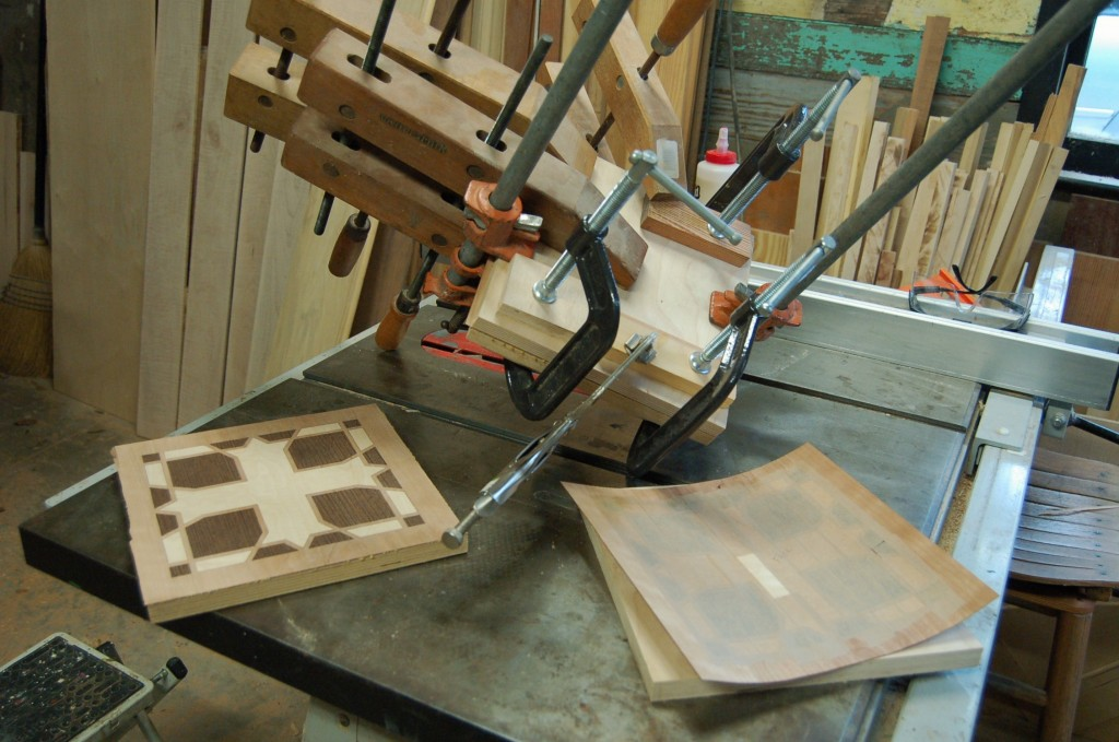 Gluing the marquetry faces for the chalice holder