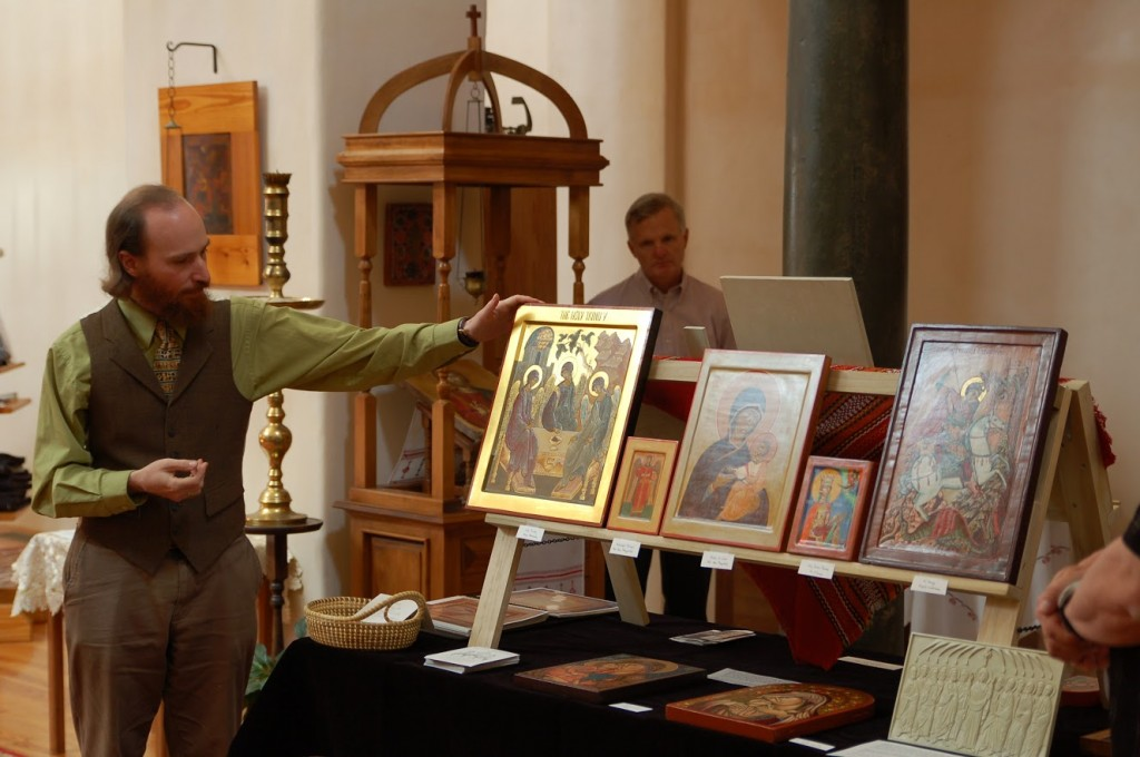 Andrew Gould explaining the exhibition of icons