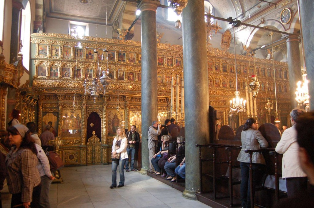 From a distance, this iconostasis seems alive with fiery light and energy, and establishes a magnificent liturgical ethos in a structure that would otherwise be dull, with its flat gray color scheme.