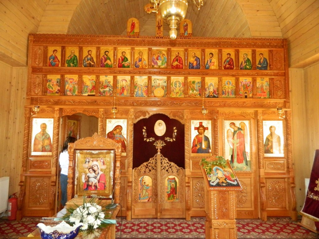 The Iconostasis of the Church of Saint Basil the Great, Curtea de Arges, Romania. This is a rather successful icon screen, because the warm gold color of the wood integrates well with the icons, and the simple design of the screen does not distract from the relationships between the icons.
