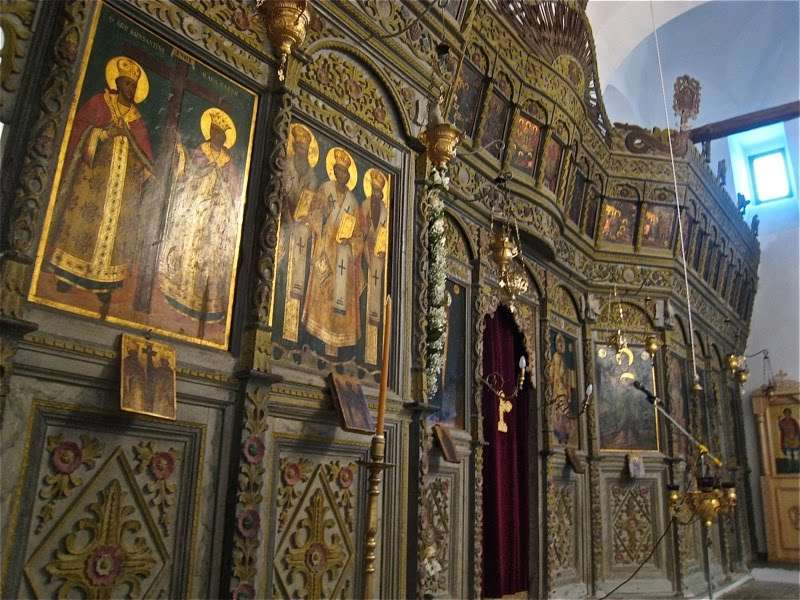 Xinovrysi, Greece, Dormition Church. This screen, made in 1819, has an unusual dark color scheme which perfectly integrates with the dark palette of the icons.