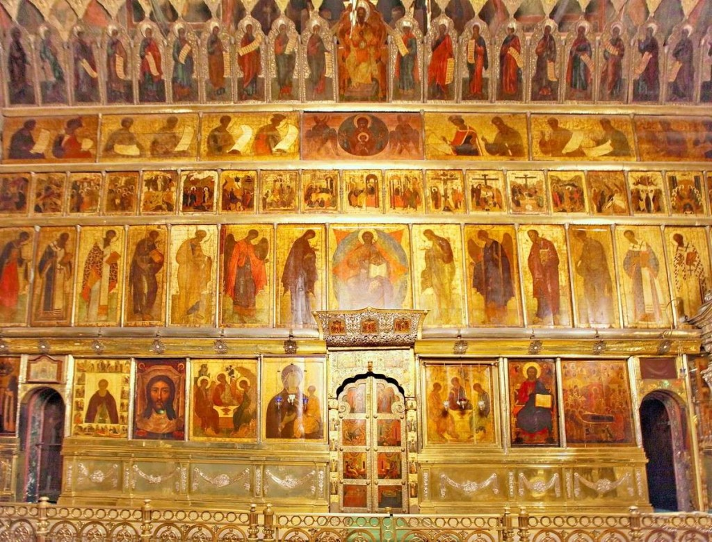 The 15th-century iconostasis in Holy Trinity Cathedral at Serguiev Possad, Russia. Typical of an early Russian screen, the structure between the icons is as discreet as possible.