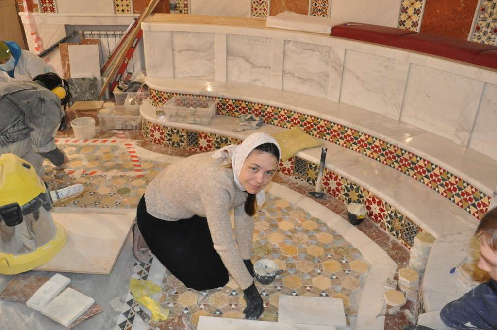 Laying the floor in the altar.
