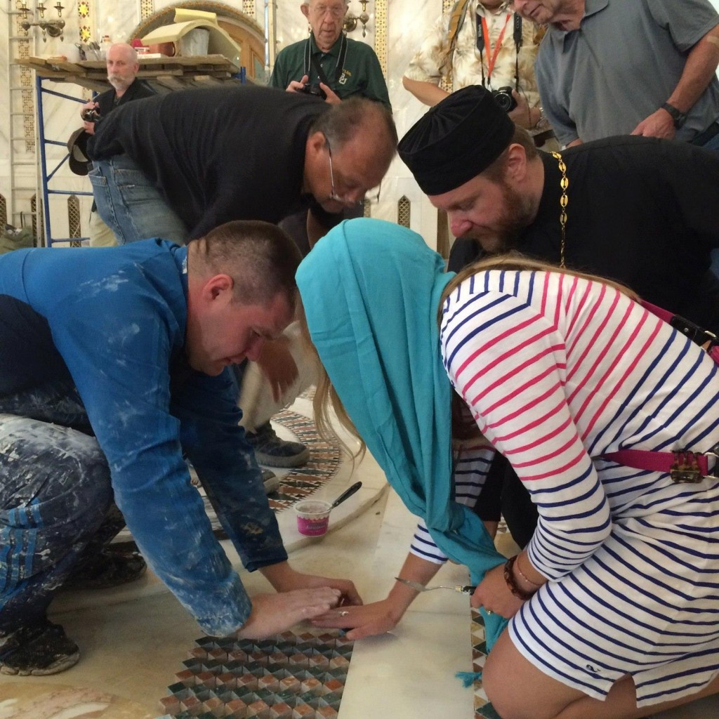Tour participants on the 2015 tour were invited to help lay the marble floor tiles in the church at Yasenevo.
