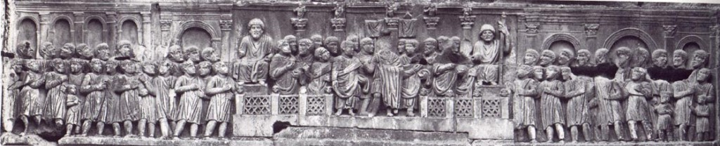 18. An example of Late Antique art, showing a more abstract arrangement of forms, such as vertical perspective. From the Arch of Constantine c. 320 AD,, Rome.