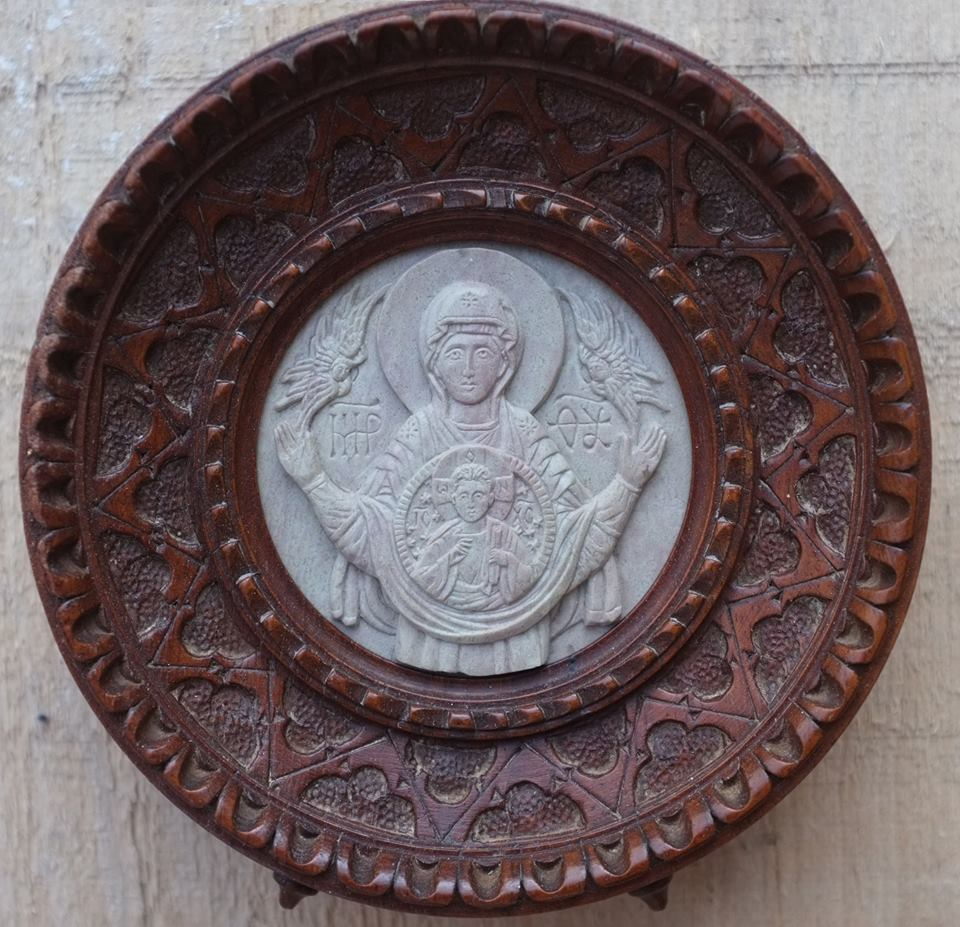"""The frame and picture, the shell and pearl.  Virgin of the Sign in steatite. 3"""" in diameter.  By the author."""