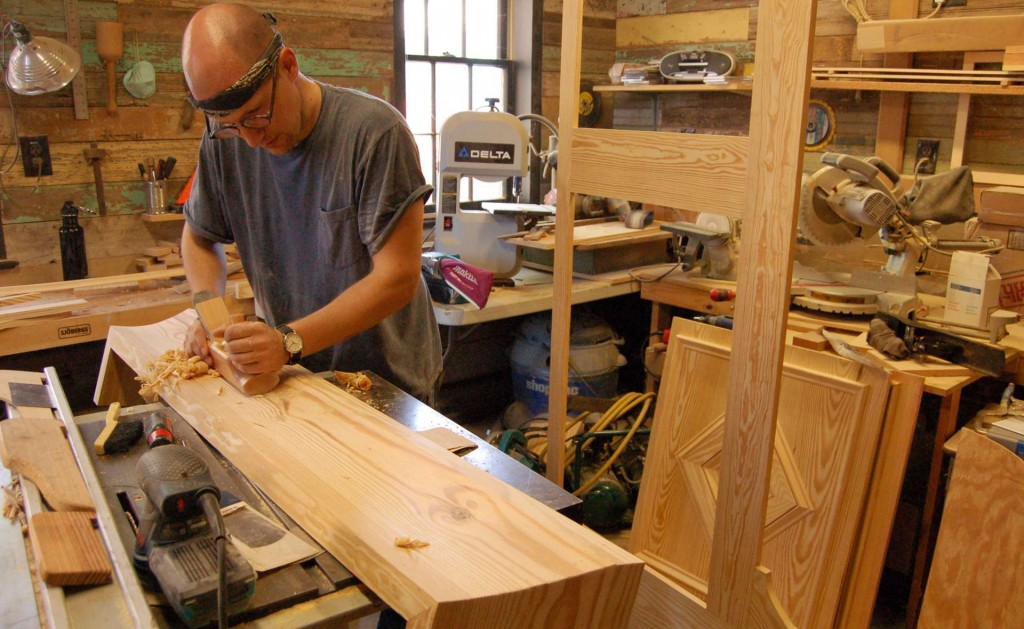 My assistant, Tom Podhrazsky, shaping the cornice from a 2x12 using a round-bottomed plane.