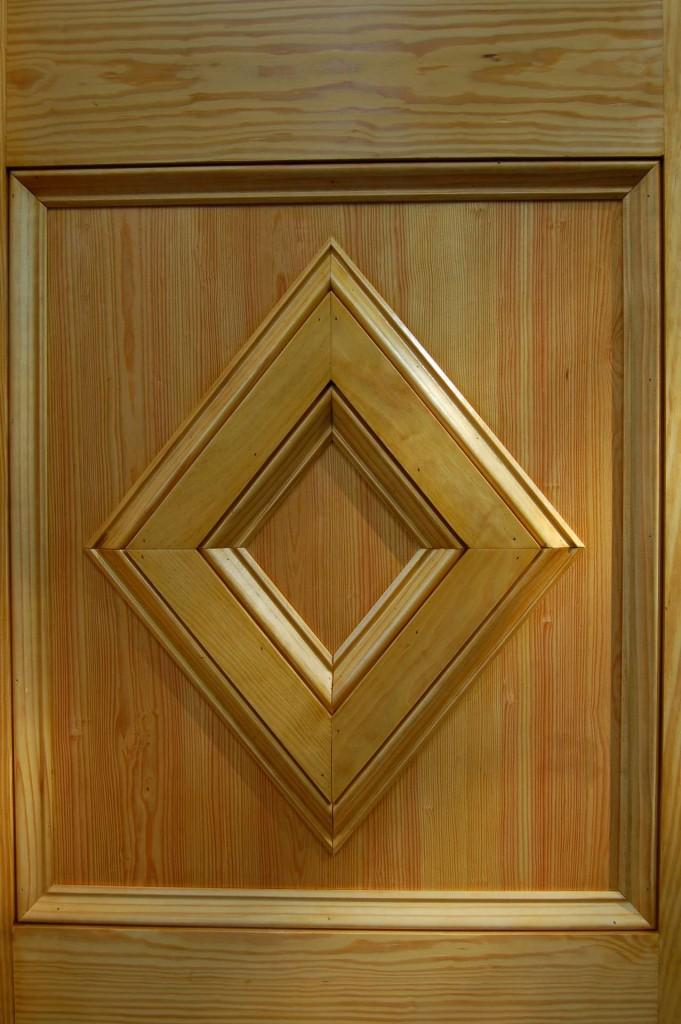 """The bottom panels are made from 3/4"""" pine boards outlined with panel moulding (a.k.a. baseboard moulding)."""