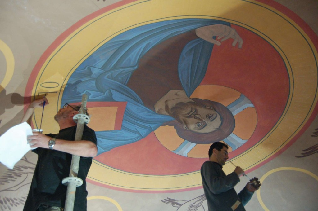 Dmitri painting the inscription around the Pantocrator, and Aleko painting the borders,