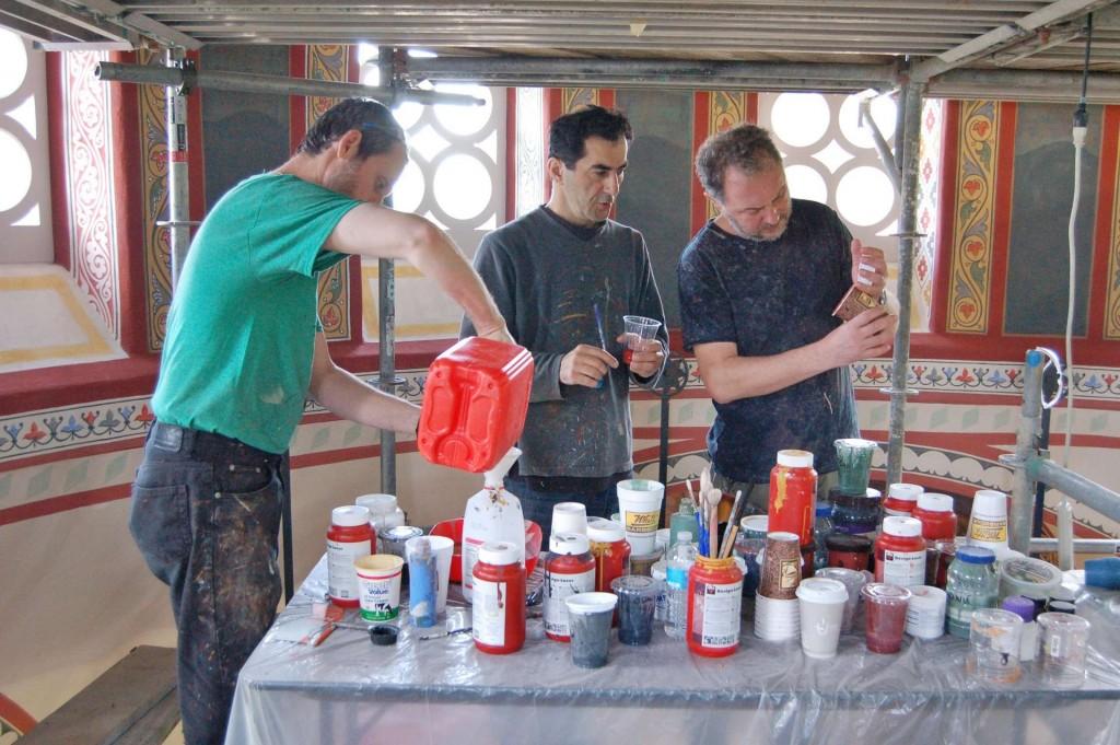 The three painters - Vladimir, Aleko, and Dmitri, mixing paints.