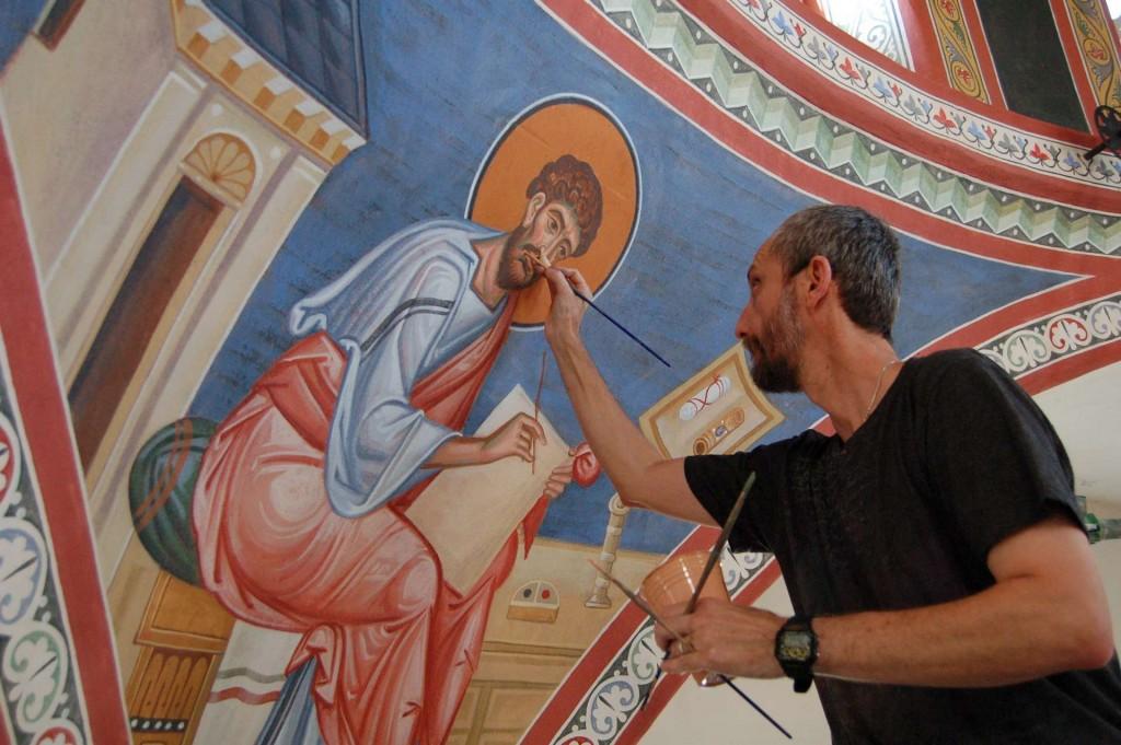 Vladimir Grygorenko painting the pendentives.