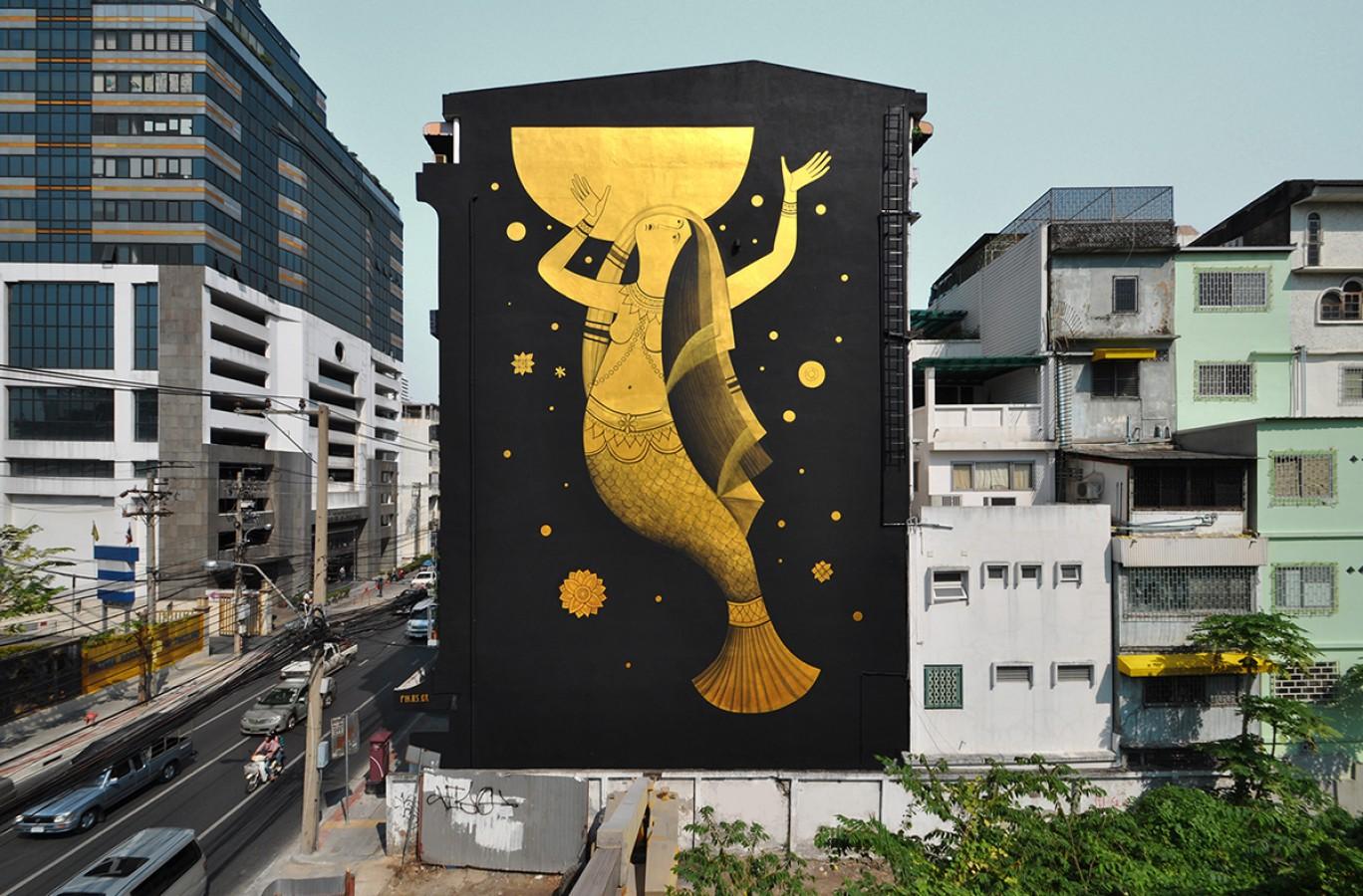 Mural for the Bukruk Festival, by Fikos, 2016. Acrylics on wall, 23×13 m. Sovann Macha-Bangok, Thailand.