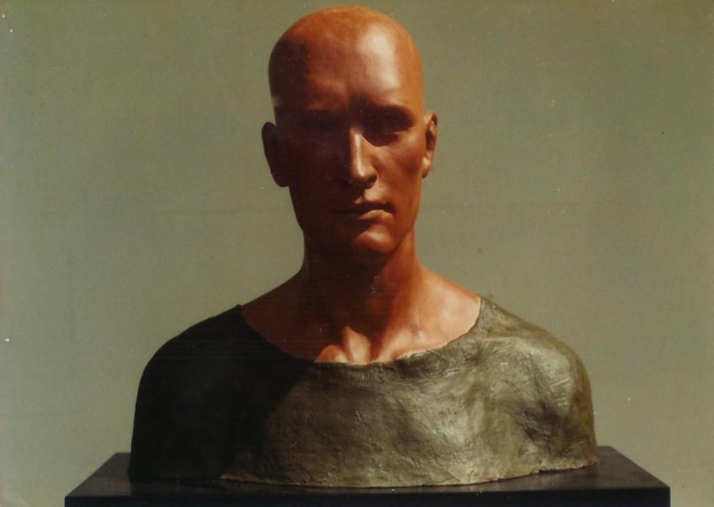 Man in Green Shirt. By Aidan Hart, 1982. Ceramic, pigmented plaster, fabric.