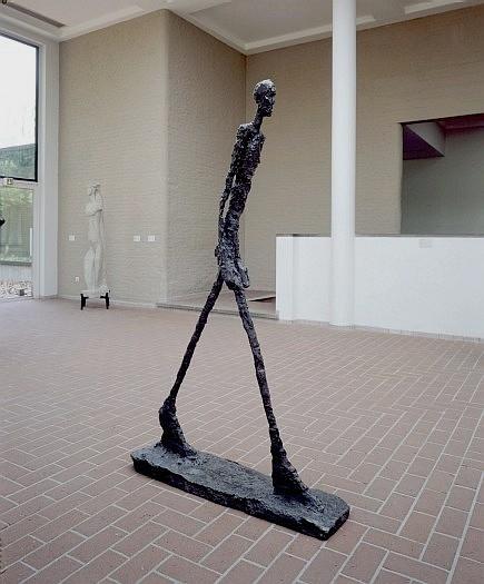 The Walking Man I. By Alberto Giacometti, 1960.