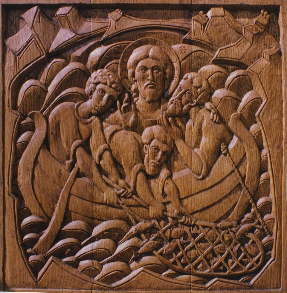 An oak carving of the miracle of fishes, Iviron Monastery, Mount Athos, by Aidan Hart. The design was adapted as the work was carved.