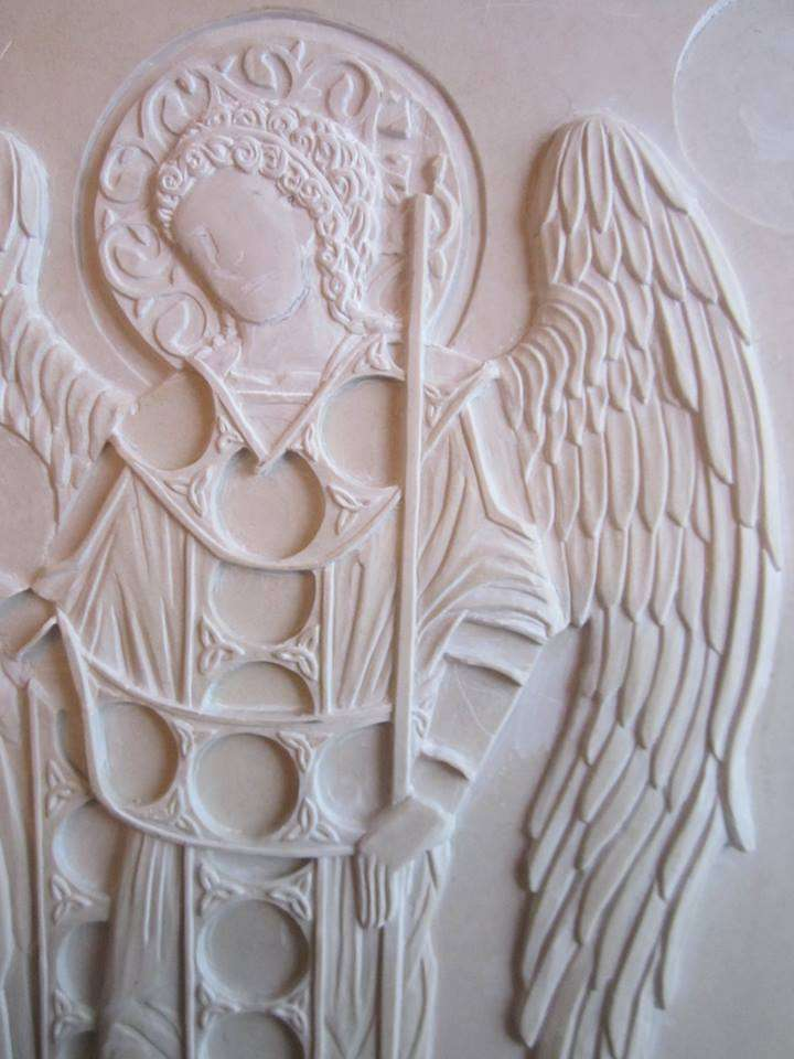 Carving the detail.