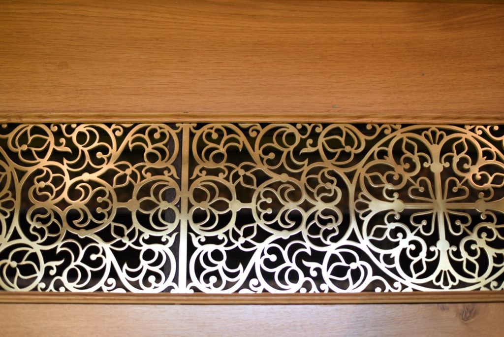 A radiator grill, water jet cut out from plate brass. Design by Aidan Hart.